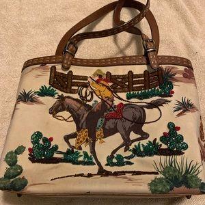 Isabella Fiore cowboy handbag